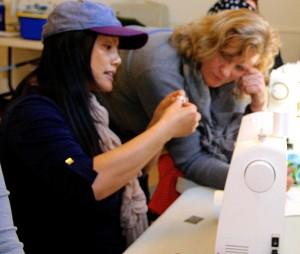 Annie teaching sewing